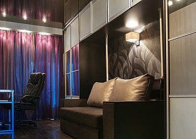 beautiful interior of a wardrobe and a sofa and the workplace